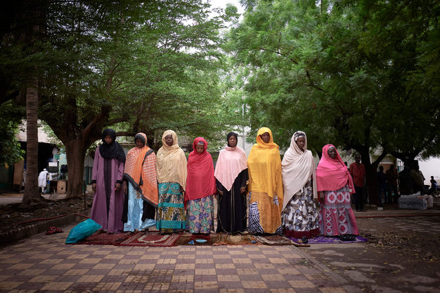 A group of women is seen praying in the courtyard of the Roi Faycal Bin Abdoulaziz Mosque during Eid al-Fitr, the holiday that marks the end of the Holy Month of Ramadan, in Bamako on May 12, 2021. (Photo by Michele Cattani/AFP Photo)