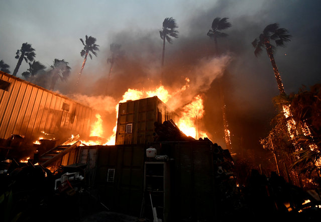 A home is engulfed in flames during the Woolsey Fire in Malibu, California, U.S. November 9, 2018. (Photo by Gene Blevins/Reuters)