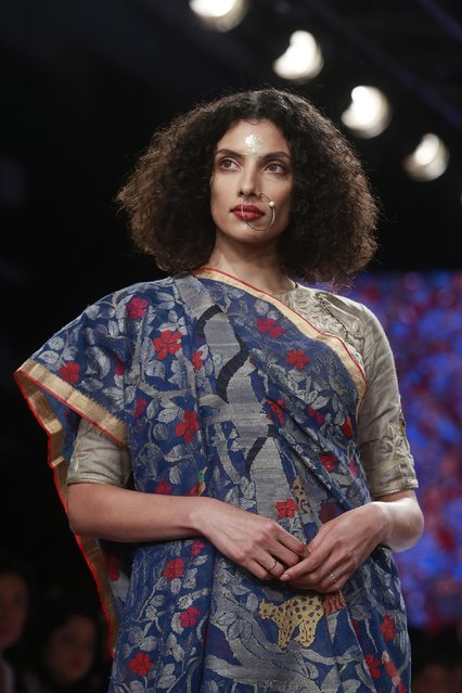 A model displays a creation by Gaurang during the Lakme Fashion Week Summer Resort 2015 in Mumbai, India, Thursday, March 19, 2015. (Photo by Rafiq Maqbool/AP Photo)