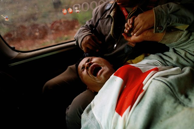 Moe Kyaw Than, 45, a volunteer with the Myanmar Red Cross Society reacts after he was wounded when the convoy he was in was fired upon by the Myanmar National Democratic Alliance Army (MNDAA), between the capital of Kokang, Laukkai, and Chinshwehaw, February 17, 2015. (Photo by Soe Zeya Tun/Reuters)