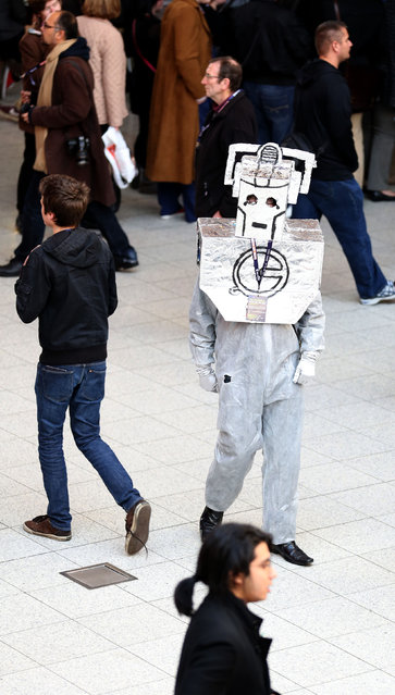 A person dressed as a Cyberman from Doctor Who strolls along during a visit to the Doctor Who Official 50th Celebration at the London Excel Centre Docklands, on November 22, 2013. (Photo by Chris Radburn/PA Wire)