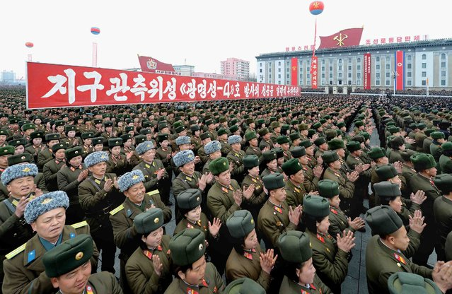 This photo dated on February 8, 2016 and released by North Korea's official Korean Central News Agency (KCNA) on February 9, 2016 shows North Korean people and soldiers celebrating a report on North Korea's rocket launch in Pyongyang. North Korea said on February 7, it had successfully put a satellite into orbit, with a rocket launch widely condemned as a ballistic missile test for a weapons delivery system to strike the US mainland. (Photo by AFP Photo/KCNA via KNS)