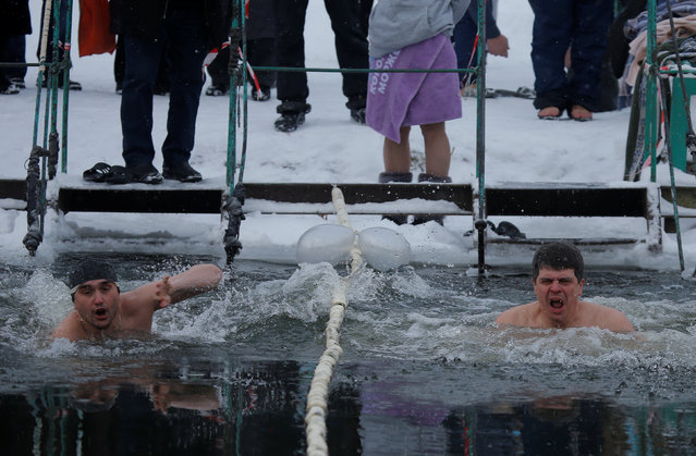 Participants take part in a festival of winter swimming in the town of Podolsk, south of Moscow, Russia January 5, 2017. (Photo by Maxim Shemetov/Reuters)