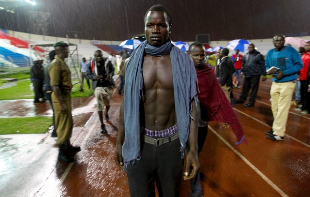 """A Garissa University student arrives at Nyayo stadium to meet his relatives in Kenya's capital Nairobi April 4, 2015, after Thursday's attack by gunmen in their campus in Garissa. Kenya's President Uhuru Kenyatta said on Saturday that those behind an attack in which al Shabaab Islamist militants killed 148 people at a university were """"deeply embedded"""" in Kenya. (Photo by Thomas Mukoya/Reuters)"""