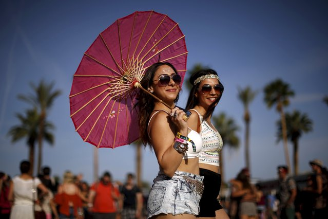 Lemeese Ghosal (L) and Reem Mansoor walk through the Coachella Valley Music and Arts Festival in Indio, California April 10, 2015. (Photo by Lucy Nicholson/Reuters)