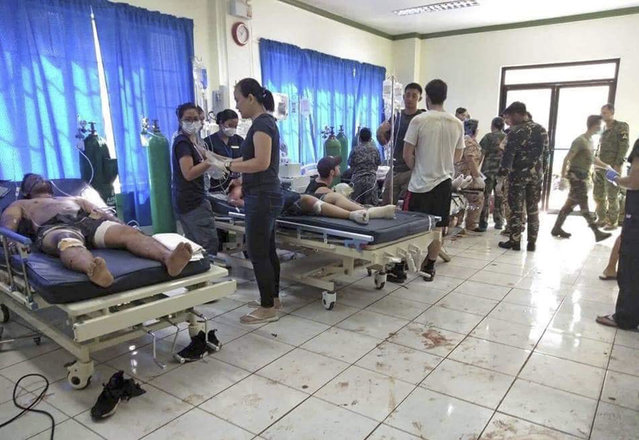 """In this photo provided by WESMINCOM Armed Forces of the Philippines, bomb victims receive treatment in a hospital after two bombs exploded outside a Roman Catholic cathedral in Jolo, the capital of Sulu province in southern Philippines where militants are active Sunday, January 27, 2019. The Philippine government says it will """"pursue to the ends of the earth the ruthless perpetrators"""" behind bomb attacks that killed over a dozen people and wounded many more during a Sunday Mass at a cathedral on the restive southern island. (Photo by WESMINCOM Armed Forces of the Philippines via AP Photo)"""