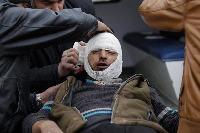 A rebel fighter receives treatment after a mine exploded on the outskirts of the northern Syrian town of al-Bab, Syria January 14, 2017. (Photo by Khalil Ashawi/Reuters)