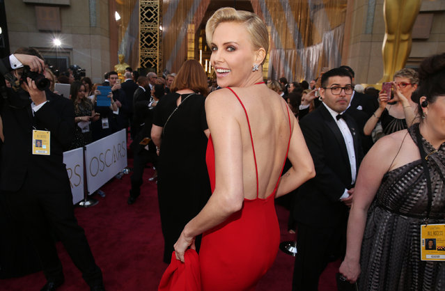 Charlize Theron arrives at the Oscars on Sunday, February 28, 2016, at the Dolby Theatre in Los Angeles. (Photo by Matt Sayles/Invision/AP Photo)