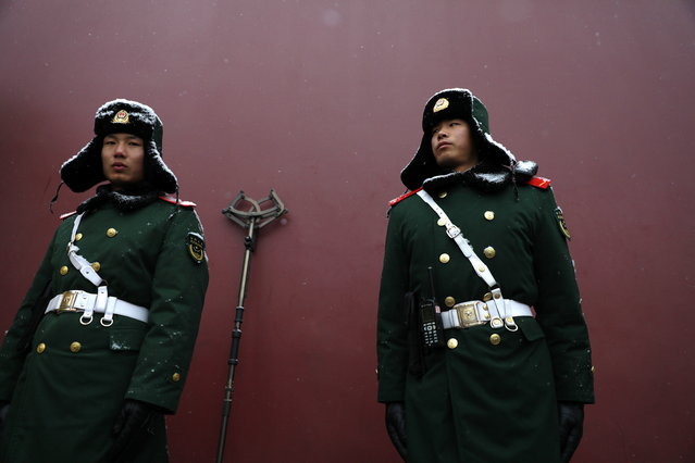 Chinese paramilitary policemen stand guard in front of Tiananmen Gate amid heavy snowfall in Beijing, China, 12 February 2019. Snowfall hit the capital, after relatively low precipitation this winter, as people returned from a weeklong spring festival holiday. (Photo by How Hwee Young/EPA/EFE)