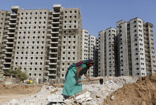 A labourer works at the site of residential building under construction on the outskirts of Ahmedabad, India, February 29, 2016. India unveiled a budget for the poor on Monday, announcing new rural aid schemes and skimping on a bank bailout, in a strategy shift that seeks to boost Prime Minister Narendra Modi's ruling party in coming state elections. (Photo by Amit Dave/Reuters)