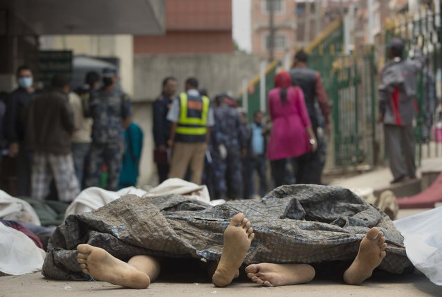 Bodies of those killed in earthquake lie at a hospital, in Kathmandu, Nepal, Sunday, April 26, 2015. (Photo by Manish Swarup/AP Photo)