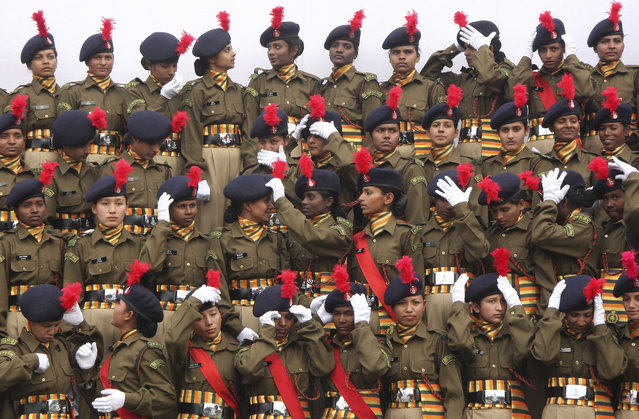 Newly raised recruits from first women battalion of Indo-Tibetan Border Police (ITBP) adjust their caps before a group photo after their passing out parade in an ITBP training centre at Bhanu, Haryana, January 29, 2010. (Photo by Ajay Verma/Reuters)