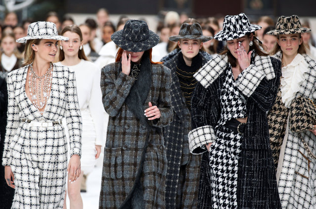 Cara Delevingne and other models react while presenting creations by late designer Karl Lagerfeld as part of his Fall/Winter 2019-2020 women's ready-to-wear collection show for fashion house Chanel at the Grand Palais during Paris Fashion Week in Paris, France March 5, 2019. (Photo by Regis Duvignau/Reuters)