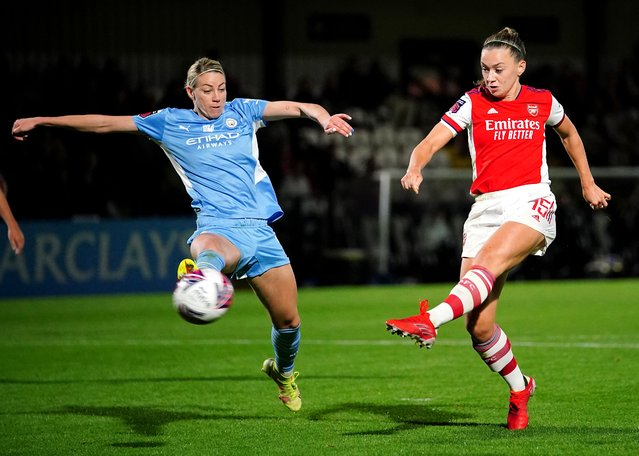 Arsenal's Katie McCabe (right) celebrates scoring their side's third goal of the game during the FA Women's Super League match at Meadow Park, Borehamwood on Sunday, September 26, 2021. (Photo by Dominic Lipinksi/PA Images via Getty Images)
