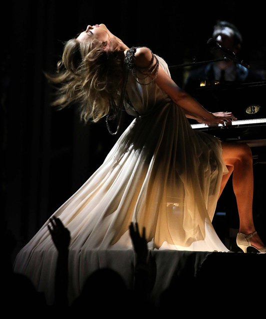 "Taylor Swift performs ""All Too Well"" at the 56th annual Grammy Awards at Staples Center. (Photo by Matt Sayles/Invision)"
