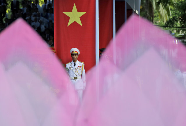 An honor guard stands in attention during a parade celebrating the 40th anniversary of the end of the Vietnam War which is also remembered as the fall of Saigon, in Ho Chi Minh City, Vietnam, Thursday, April 30, 2015. (Photo by Dita Alangkara/AP Photo)