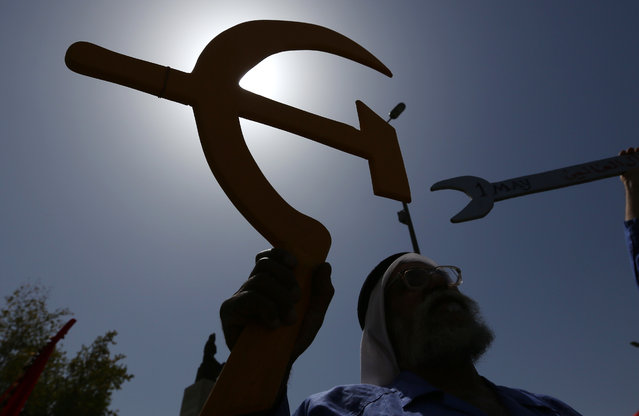 A supporter of the Iraqi Communist Party takes part in a May Day celebration in Baghdad, Iraq, Friday, May 1, 2015. (Photo by Hadi Mizban/AP Photo)