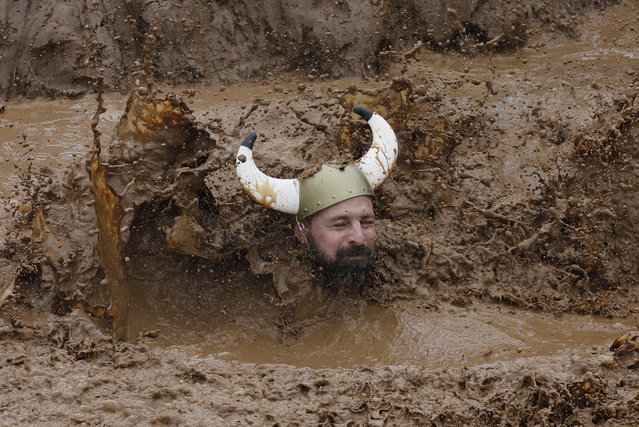 A participant makes his way through muddy water during the Tel Aviv Mud Run race in the Yarkon Park, in Tel Aviv, Israel, 29 March 2019. (Photo by Abir Sultan/EPA/EFE)
