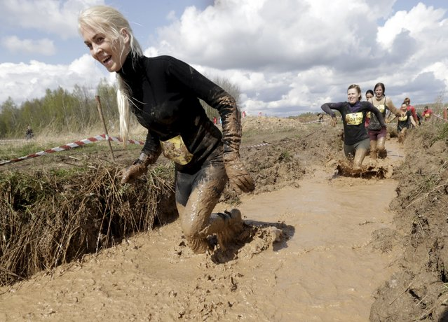 Participants compete during the Strong Race event near Tukums, Latvia, May 3, 2015. (Photo by Ints Kalnins/Reuters)