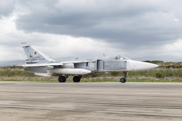 A Russian Sukhoi Su-24 front-line bomber is seen on a runway shortly before taking off, part of the withdrawal of Russian troops from Syria, at Hmeymim airbase, Syria, March 16, 2016. (Photo by Vadim Grishankin/Reuters/Russian Ministry of Defence)
