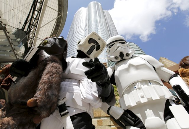 Cosplayers dressed up as Star Wars characters Scout Trooper (L) and Storm Trooper take part in a Star Wars Day fan event in Tokyo May 4, 2015. (Photo by Toru Hanai/Reuters)