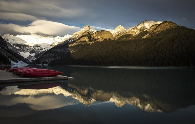Canoes are seen on a dock on Lake Louise at Banff National Park, in the Canadian Rocky Mountains outside the village of Lake Louise, Alberta, October 3, 2014. (Photo by Mark Blinch/Reuters)
