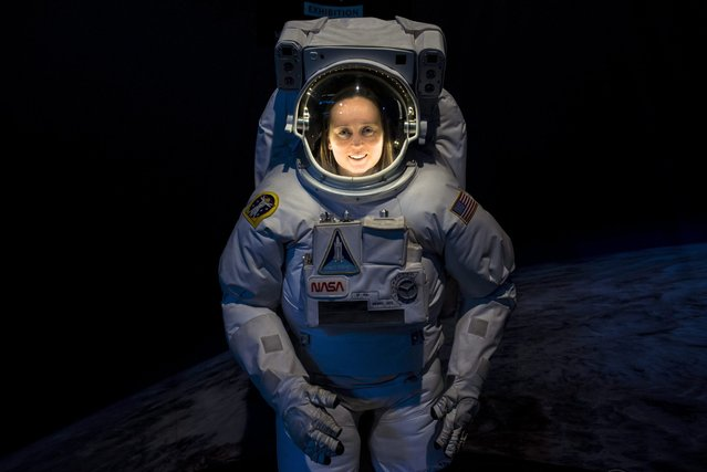 Astronomer, space scientist and meteorologist Andrea Opitz, senior research associate of the Space Physics and Space Technology Department of Hungarian Academy of Sciences (MTA) Wigner Research Centre for Physics (2R) wears a space suit during a cosmology exhibition in Budapest, Hungary, 03 March 2016. (Photo by Bea Kallos/EPA)