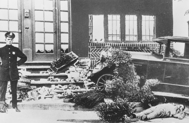 The body of noted gang chief Frankie Yale, who was born Francesco Ioele, lies beside his automobile at 44th Street, after Yale was shot to death from a pursuing automobile on July 02, 1928. Yale's car crashed into a house and he was thrown out of the car. (Photo by Bettmann/Getty Images)