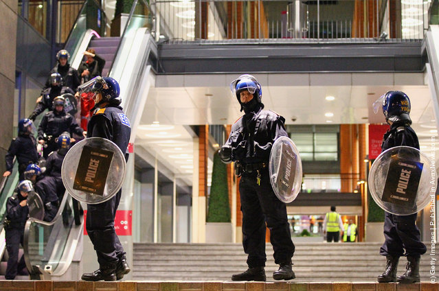 Police stand guard at the Mailbox shopping and hotel complex in Birmingham City Centre on August 8, 2011 in Birmingham, England