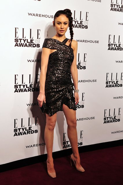 French actress and model Olga Kurylenko attends the Elle Style Awards in central London, on February 18, 2014. (Photo by Carl Court/AFP Photo)