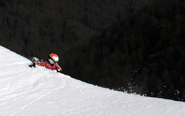 Canada's Brady Leman falls off a jump after crashing in the men's ski cross final at the Rosa Khutor Extreme Park at the 2014 Winter Olympics, Thursday, February 20, 2014, in Krasnaya Polyana, Russia. (Photo by Sergei Grits/AP Photo)