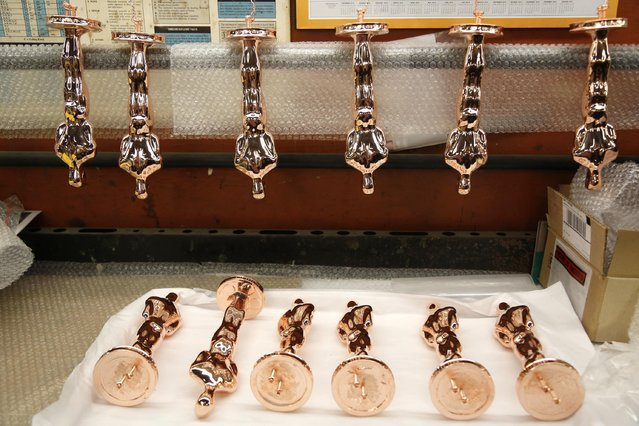 Oscar statuettes coated in copper wait for the next coating at Epner Technology in the Brooklyn borough of New York, Tuesday, January 17, 2017. Each statuette is coated in three layers – the final one the iconic gold – and every Oscar fist-pumped or tearfully cradled by Academy Award winners is first cast, buffed and fussed over by people far from Hollywood who have spent the last several months making 60 identical gold Oscars for the Feb. 26th awards. (Photo by Seth Wenig/AP Photo)