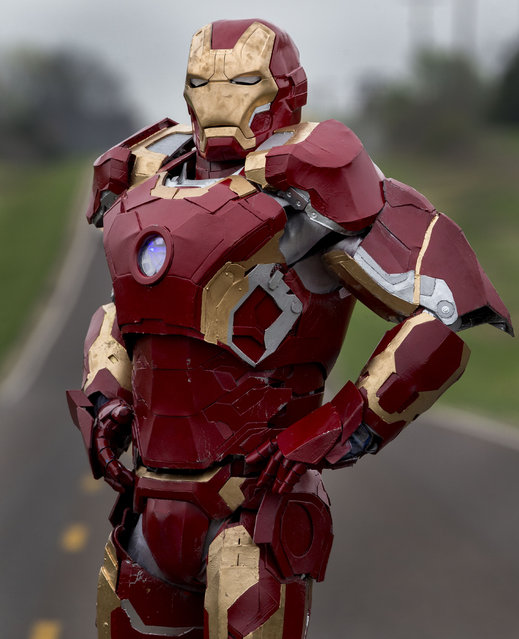 In this photo taken April 15, 2015, Clay Hielscher of Overbrook, Kan., poses for a photo in his home made Iron Man suit. (Photo by Chris Neal/AP Photo/The Topeka Capital-Journal)