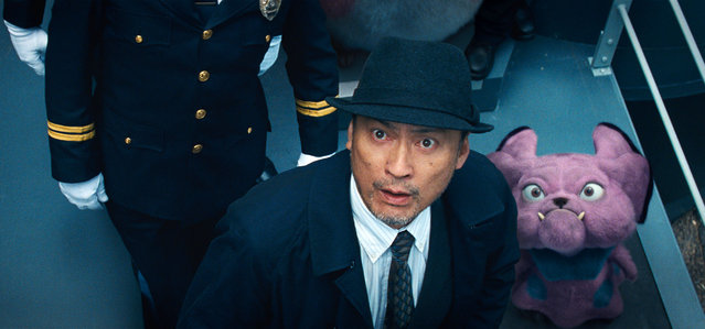 "This image released by Warner Bros. Pictures shows Ken Watanabe and the character Snubbull in a scene from ""Pokemon Detective Pikachu"". (Photo by Warner Bros. Pictures via AP Photo)"