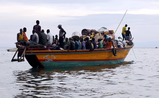 Burundian refugees sail on boat near the shores of Lake Tanganyika in Kagunga village in Kigoma region in western Tanzania to Kigoma township, May 17, 2015. (Photo by Thomas Mukoya/Reuters)