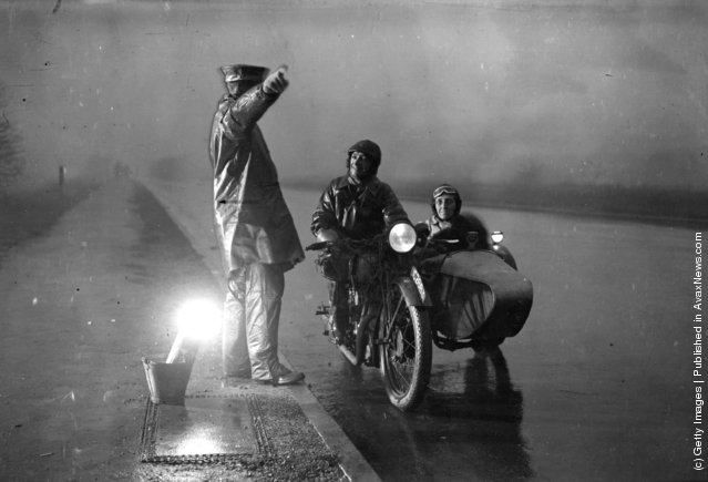 1932: An AA patrolman directs a motorcyclist who has lost his way