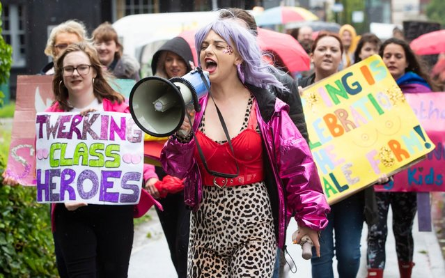 Strip club dancer Celia Lister protests with with other demonstrators to oppose moves to close a branch of Spearmint Rhino in Sheffield, England on June 11, 2019. Strip club dancers marched through a the city centre as bemused shoppers looked on. A heated row has developed over whether to renew Spearmint Rhino's licence for the premises. (Photo by Danny Lawson/PA Wire Press Association)