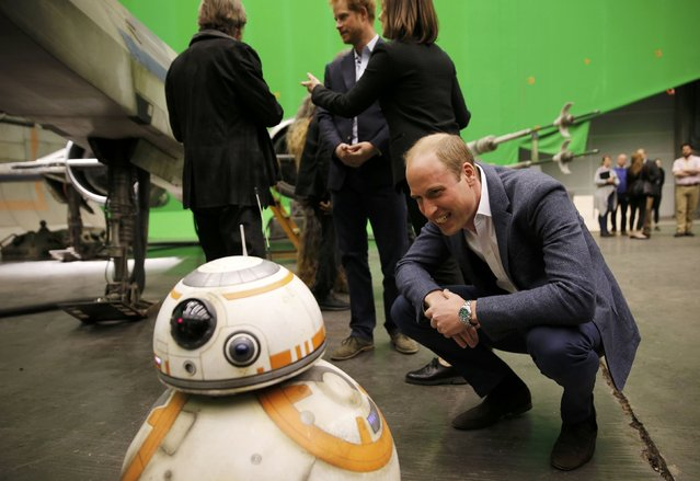 Britain's Prince William, smiles at BB-8 droid during a tour of the Star Wars sets at Pinewood studios in Iver Heath, west of London, Britain on April 19, 2016. (Photo by Adrian Dennis/Reuters)