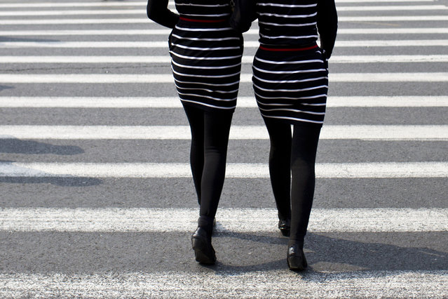 Women walk on a pedestrian cross in central Shanghai April 8, 2014. (Photo by Aly Song/Reuters)