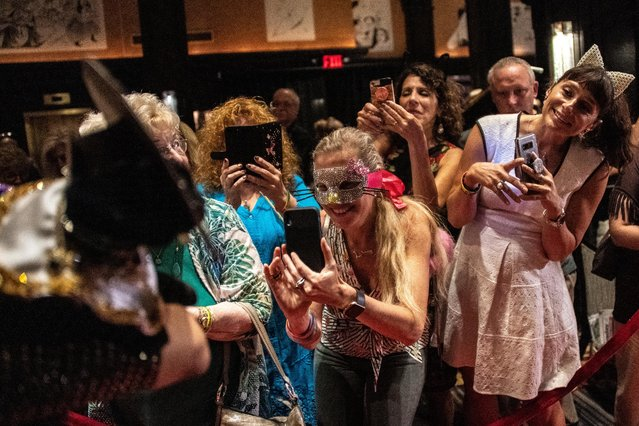 "Participants take a picture of Meril during the Algonquin Hotel's Annual Cat Fashion Show in the Manhattan borough of New York City, New York, U.S., August 1, 2019. All the proceeds of the event went to the Mayor's Alliance for New York City Animals, which helps find homes for stray cats and dogs. ""We want people to be aware that adoption is the only option"", said event organizer Alice De Almeida. (Photo by Jeenah Moon/Reuters)"