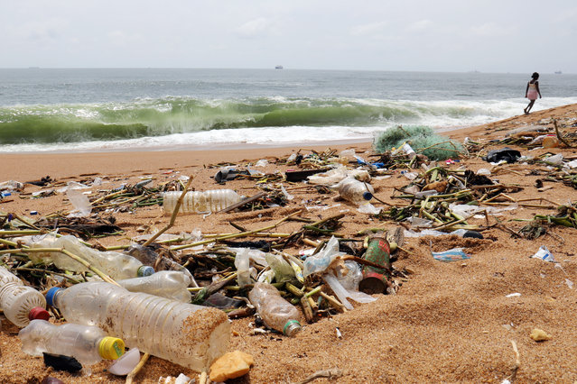 Plastic items and other debris are seen on Vridi beach in Abidjan, Ivory Coast on November 21, 2018. (Photo by Thierry Gouegnon/Reuters)