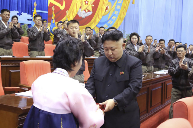 North Korean leader Kim Jong Un is applauded during the first meeting of the airpersons of the Korean People's Army (KPA) in Pyongyang April 15, 2014, in this photo released by North Korea's Korean Central News Agency (KCNA) on April 20, 2014. (Photo by Reuters/KCNA)