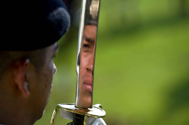A member of the Mexican Army during the ceremony of the Second Trilateral Meeting of Defense Ministers at the Campo Marte in Mexico City, on April 24, 2014. (Photo by Alfredo Estrella/AFP Photo)