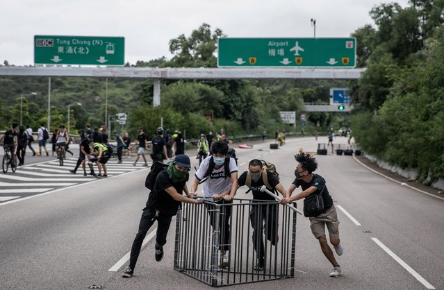 Protesters make a barricade on the freeway leading to Hong Kong International Airport on September 1, 2019 in Hong Kong, China. Pro-democracy protesters have continued rallies on the streets of Hong Kong against a controversial extradition bill since 9 June as the city plunged into crisis after waves of demonstrations and several violent clashes. (Photo by Chris McGrath/Getty Images)