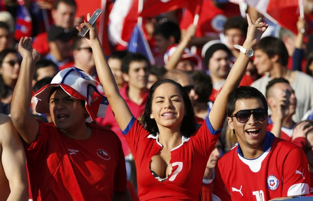 Chile fans cheer ahead of the team's Copa America 2015 final soccer match against Argentina at the National Stadium in Santiago, Chile, July 4, 2015. (Photo by Jorge Adorno/Reuters)
