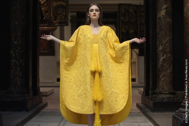 Model Bianca Gavrilas wears a a hand-embroidered cape made from the silk of the Golden Orb Spider in the V&A Museum's Medieval and Renaissance Gallery