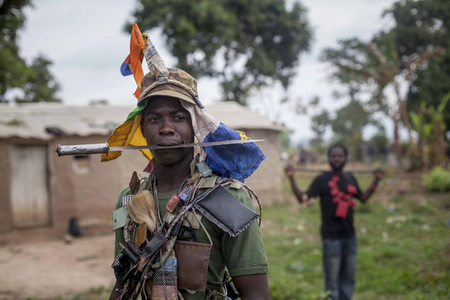 Anti-balaka fighters from the town of Bossembele patrol in the Boeing district of Bangui, Central African Republic, February 24, 2014. (Photo by Camille Lepage/Reuters)