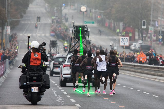 Kenya's Eliud Kipchoge (white jersey) takes the start of his attempt to bust the mythical two-hour barrier for the marathon on October 12 2019 in Vienna. Kipchoge holds the men's world record for the distance with a time of 2hr 01min 39sec, which he set in the flat Berlin marathon on September 16, 2018. He tried in May 2017 to break the two-hour barrier, running on the Monza National Autodrome racing circuit in Italy, failing narrowly in 2hr 00min 25sec. (Photo by Alex Halada/AFP Photo)
