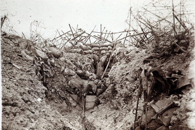 An undated archive picture shows a French soldier in a sap trench just after being shelled at Mont Tetu near Massiges, eastern France. (Photo by Collection Odette Carrez/Reuters)