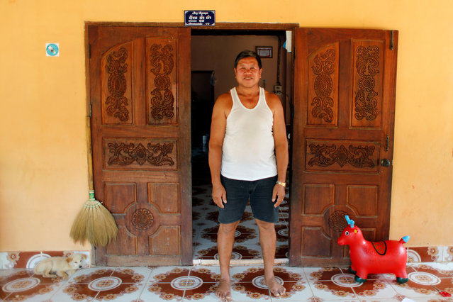 """Kongkaew Vonusak, who rents his land to a Chinese banana company stands outside his house in the province of Bokeo in Laos April 26, 2017. Kongkaew Vonusak smiles when he recalls the arrival of Chinese investors in his tranquil village in northern Laos in 2014. With them came easy money, he said. The Chinese offered villagers up to $720 per hectare to rent their land, much of it fallow for years, said Kongkaew, 59, the village chief. They wanted to grow bananas on it. In impoverished Laos, the offer was generous. """"They told us the price and asked us if we were happy. We said okay"""". Elsewhere, riverside land with good access roads fetched at least double that sum. Three years later, the Chinese-driven banana boom has left few locals untouched, but not everyone is smiling. Experts say the Chinese have brought jobs and higher wages to northern Laos, but have also drenched plantations with pesticides and other chemicals. Last year, the Lao government banned the opening of new banana plantations after a state-backed institute reported that the intensive use of chemicals had sickened workers and polluted water sources. (Photo by Jorge Silva/Reuters)"""